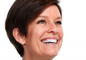 Mature woman smiling happy white smile after successful cosmetic dentistry