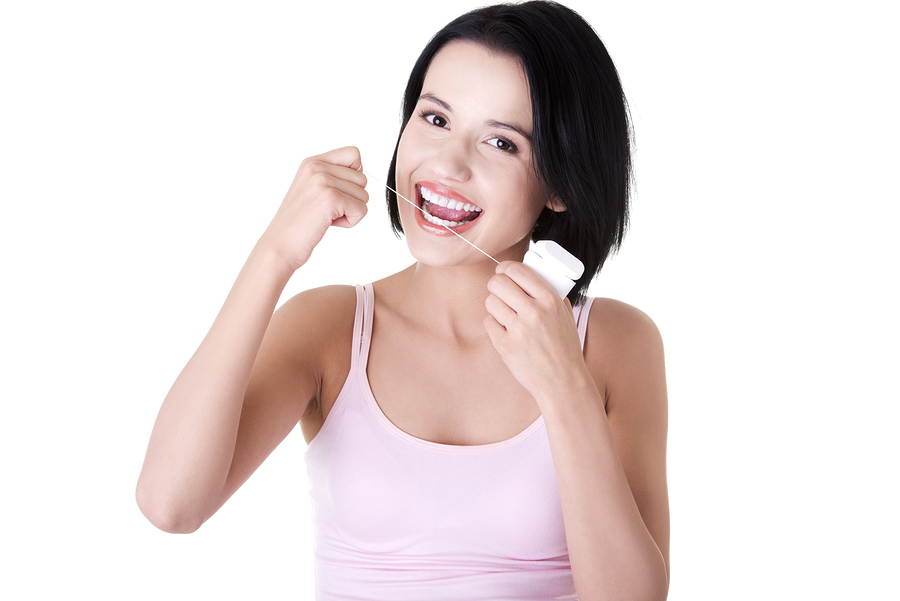 Picture of woman flossing for oral home care