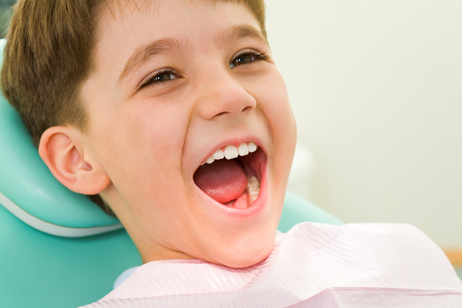 Picture of child ready for dental exam