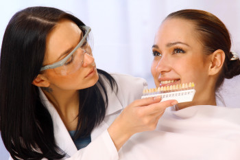 Picture of dentist matching colors for composite filling