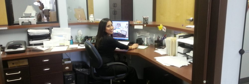 Our office and smiling receptionist!