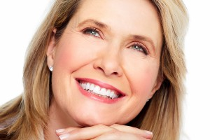 beautiful older woman showing teeth after cosmetic dentisty