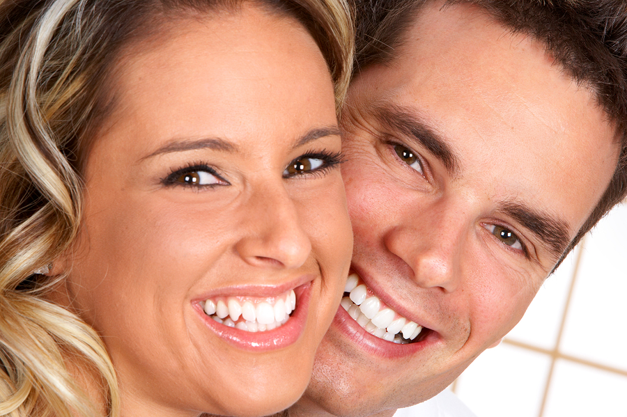 Young smiling couple showing bright, white teeth