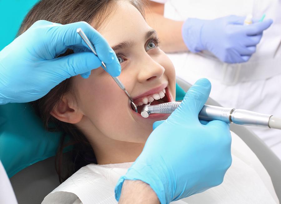 laser dental treatment for a little girl