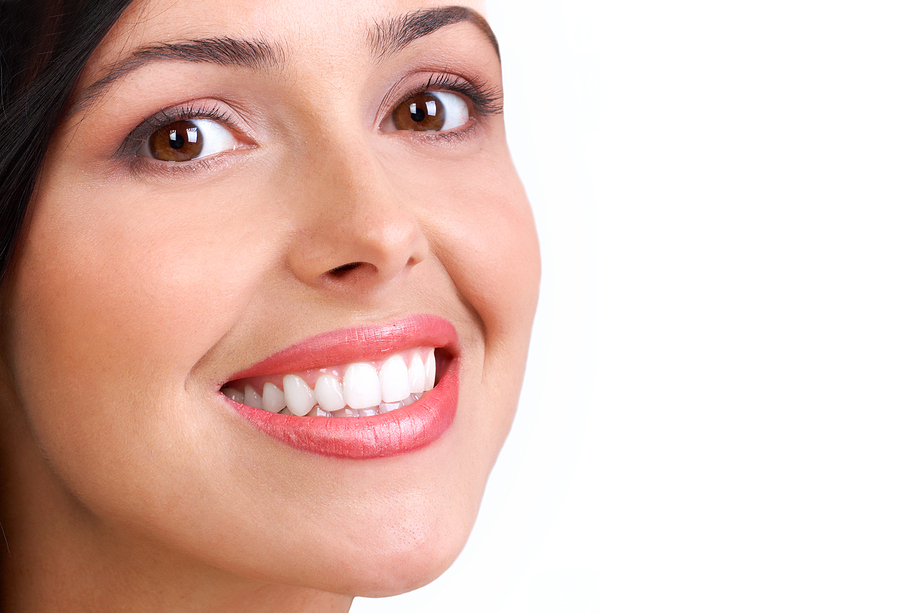 Smiling young woman face with perfect teeth.