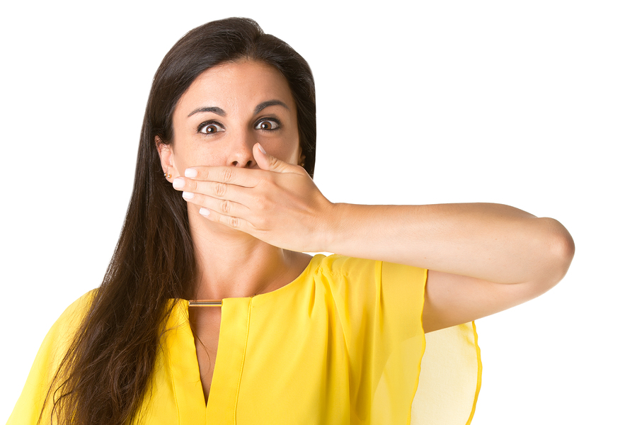 Female covering her mouth with her hand due to periodontitis