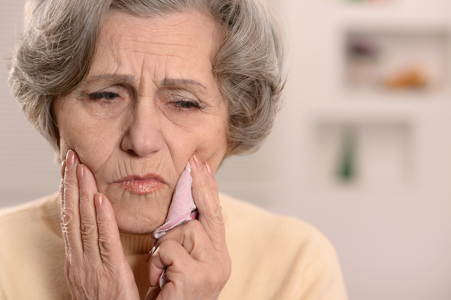 Elderly nice woman having bad tooth pain